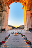 Arc Tomb. Beautiful view from under the Arc de Triomphe in Paris, France, with the tomb of the unknown soldier Stock Photography