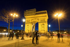 Arc tourists. Beautiful night view of the Arc de Triomphe in Paris, France Stock Photos