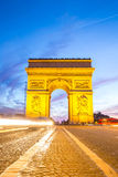 Arc of Triomphe Champs Elysees Paris. City at sunset Royalty Free Stock Images