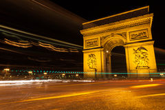 Arc of Triumph. In Avenue of Champs-Elysees at night Stock Images