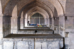 Arc way and man with bicycle. Arc bridge in Esfahan, Iran Stock Photo