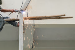 Arc welder cutting steel pipe. With acetylene welding Royalty Free Stock Photography