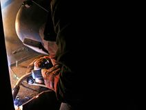 Arc welder welding connections. Steel worker welding corner of an indoor Stock Photos