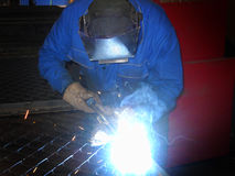 Arc welder with welding sparks. Welder welding a steel beam Royalty Free Stock Image
