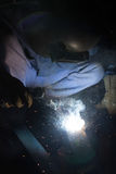 Arc welder with welding sparks Royalty Free Stock Photos