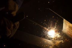 Arc welder with welding sparks. Welder with sparks arcing, industrial background Royalty Free Stock Photography