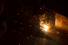 Arc welder with welding sparks Royalty Free Stock Photo
