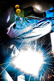 Arc welder with welding sparks. Welder with sparks arcing, industrial background Stock Photo