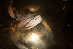 Arc welder with welding sparks. Welder with sparks arcing, industrial background Stock Photos