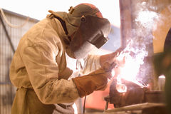 Arc Welder. On work with protective helmet Royalty Free Stock Photography