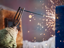 Arc welder worker in protective mask welding metal construction Royalty Free Stock Image