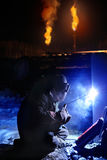 Arc Welder working on the Oil Field. In the Winter Night Stock Images