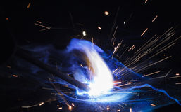 Arc welding closeup. On black background Stock Image