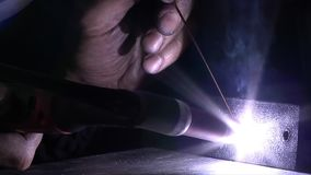 Arc welding in the dark stock video footage