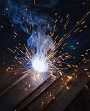 Arc welding. Fire on steel Stock Photo