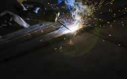 Arc welding and welding fumes. Arc welding and welding fumes at the factory welding closeup royalty free stock image