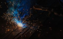 Arc welding and welding fumes at the factory. Arc welding and welding fumes at the factory welding closeup on steel stock photo