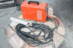 Arc welding machine with welding electrodes on table.  Stock Photo