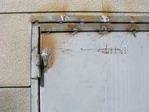 Weld seams on metal door frame, welded door hinge, close-up. Arc welding on the old metal door. Weld seams on metal door frame and door hinge. Close-up Stock Photography