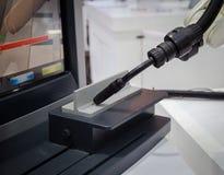 Arc welding robot. Arm weld on tee bar Stock Photo