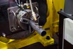 Arc welding robot. 6 axis robotic arc machine welding nipple to pipe Stock Images
