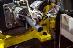 Arc welding robot. 6 axis robotic arc machine welding nipple to pipe Stock Photos