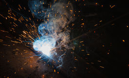 Arc welding. Smoke and fire Stock Photo