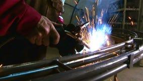 Arc welding steel pipe stock footage