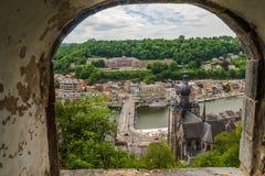 Arc window view of beautiful Dinant city from citadel of dinant, namur, belgium