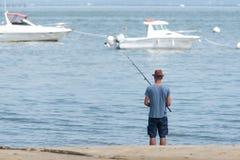 Arcachon, Франция, рыболов на пляже стоковые изображения