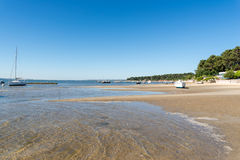 Arcachon Bay, France, beach at low tide. Beach at low tide and oyster bed near the Cap Ferret, in front of the dune of Pyla, or dune of Pilat Stock Photo