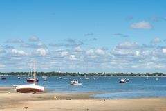 Arcachon Bay, France, a beach at low tide. Sailboat at lowtide on a small beach of the Arcachon Bay Royalty Free Stock Photography