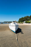 Arcachon Bay, France, beach at low tide. SAilboat on the beach at low tide near the Cap Ferret Stock Images