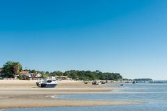 Arcachon Bay, France, boats at low tide. Houses on the beach and boats at low tide near the Cap Ferret on the Arcachon Bay Stock Image