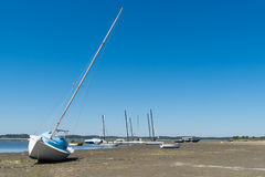 Arcachon Bay, France, boats at low tide. Sailboat on the sand at low tide in Arès, Arcachon Bay Royalty Free Stock Image