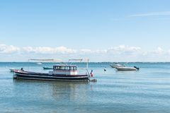 Arcachon Bay, France, boats on water in summer. Boats on water near the Cap Ferret on the Arcachon Bay Stock Photo