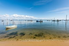 Arcachon Bay, France, fishing boats on water. View on the Arcachon Bay from the beach of the Point of Horses, near the Cap Ferret Stock Photo