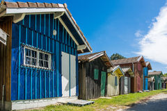 Arcachon Bay, France, oyster huts. Colored oyster huts in the oyster village of Biganos in the Arcachon Bay Stock Images