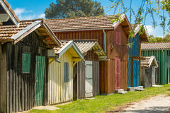 Arcachon Bay, France, oyster huts. Colored oyster huts in the oyster village of Biganos in the Arcachon Bay Stock Image