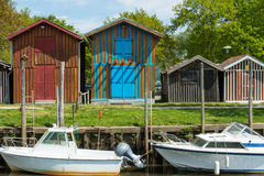 Arcachon Bay, France, oyster huts. Colored oyster huts in the oyster village of Biganos in the Arcachon Bay Royalty Free Stock Image