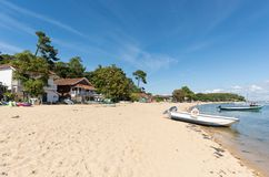 Arcachon Bay, France, A small beach at summer. Houses and boats on the beach of the cove called The Point of Horses, near the Cap Ferret Royalty Free Stock Photo