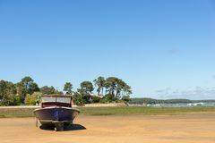 Arcachon Bay, France, typical fishing boat. A typical fishing boat of the Arcachon Bay at low tide Royalty Free Stock Images