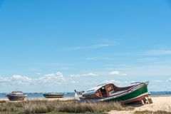 Arcachon Bay, France, typical fishing boats. Typical fishing boats at low tide Stock Photos