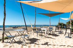 Arcachon Bay, France, typical oyster restaurant. Terrace of an oyster restaurant on the beach in front of the dune of Pyla or dune of Pilat Stock Photos