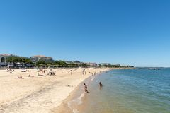 Arcachon, France, beach, jetty and seafront. The central beach of Arcachon in summer, with the jetty Thiers at the background, and the seafront with its hotels Royalty Free Stock Photos