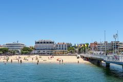 Arcachon, France, beach, jetty and seafront. The central beach of Arcachon in summer, with the jetty Thiers and the seafront with its hotels and restaurants. The Stock Images