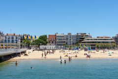 Arcachon, France, beach, jetty and seafront. The central beach of Arcachon in summer, with the jetty Thiers and the seafront with its hotels and restaurants. The Stock Photos