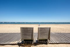 Arcachon, France, bike path and public benches on the beach. A bike path with public benches runs along the beach of Arcachon, a famous seaside resort in France Royalty Free Stock Photography