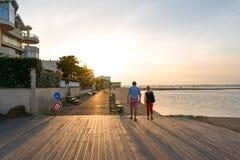 Arcachon, France, boardwalk at sunset. Boardwalk on the beach of Arcachon Royalty Free Stock Image