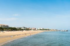 Arcachon, France. The central beach, the jetty and part of the city. The main beach of Arcachon, in France Royalty Free Stock Photo